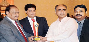 Receiving Award from President Mr. Mamnoon Husain