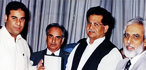 Receiving Best Performer of P.C.S.I.R Exhibition Image Pakistan Award year 2003 from The Co-ordinator to Chief Minister of the Punjab Mr. Rana Ijaz