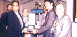 Receiving Participation Award from Provincial Housing Minister Mr. Syed Raza Ali Gillani