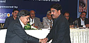 Receving Participation Award from Architect Nayyar Ali Dada