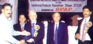 Receiving Participation Award from British High Commissioner